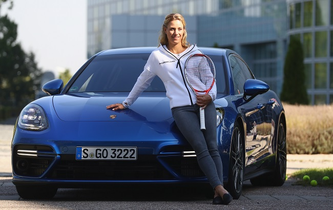 MUNICH, GERMANY - SEPTEMBER 13:  Angelique Kerber of Germany poses in front of a new Porsche Panamera Turbo after returning as new Tennis World number One and winner of the US Open at Munich  Airport on September 13, 2016 in Munich, Germany.  (Photo by Alexander Hassenstein/Getty Images For Porsche)